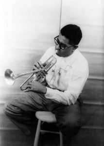 Dizzy_Gillespie_playing_horn_1955